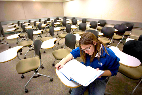 student studying in empty classroom