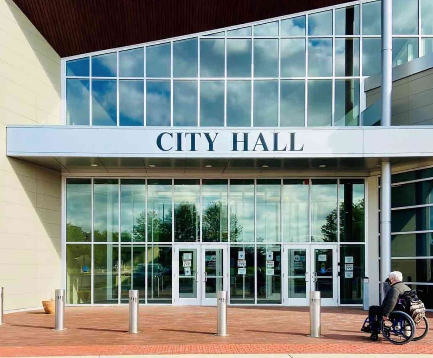 picture of man in wheelchair in front of a city hall