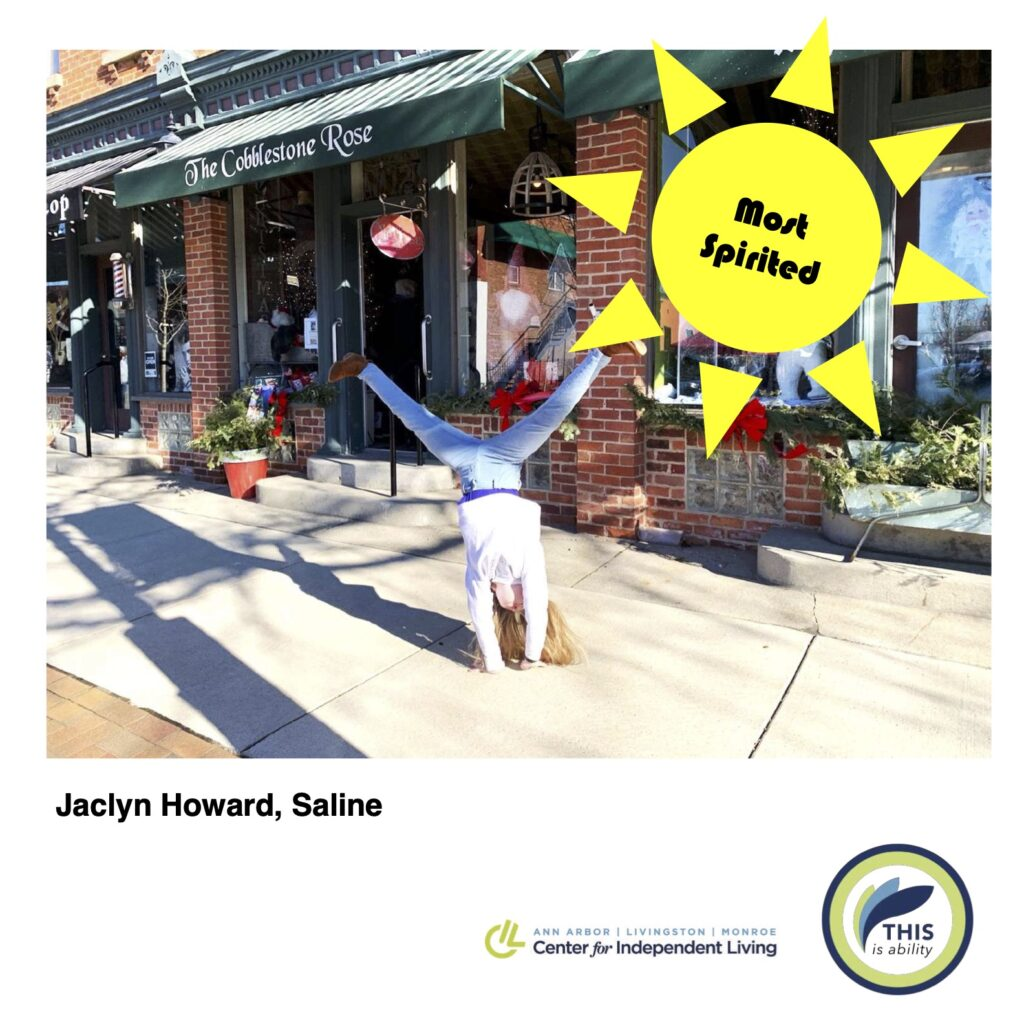 Jacklyn Howard, saline, doing a cartwheel downtown saline with most spirited graphic overlay