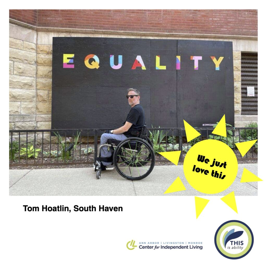 Tom Hoatlin, South Haven, in front of equality sign in Chicago